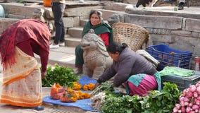 BHAKTAPUR, KATHMANDU, NEPAL - 18 October 2018 Asian people selling goods in national clothes, morning fruit vegetables stock footage