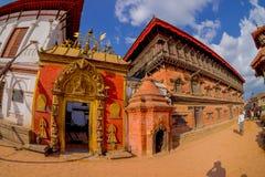 BHAKTAPUR, NEPAL - NOVEMBER 04, 2017: Beautiful golden door of a temple located in the center of Durbar Square in. Bhaktapur, Kathmandu valey, Nepal, fish eye stock photography