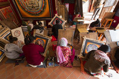 BHAKTAPUR, NEPAL - NOVEMBER 20: Nepalese artists creates traditi Stock Image