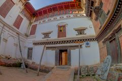 BHAKTAPUR, NEPAL - NOVEMBER 04, 2017: Outdoor view of old house located in dowtown located in Bhaktapur, Nepal, fish eye Stock Images