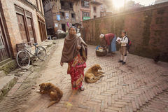 BHAKTAPUR, NEPAL - NOVEMBER 20: People working in Bhaktapur on N Royalty Free Stock Photos