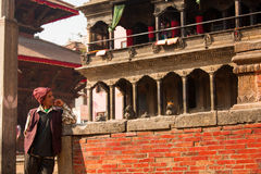 BHAKTAPUR, NEPAL - NOVEMBER 20: Portrait of unkown man staying a Royalty Free Stock Image