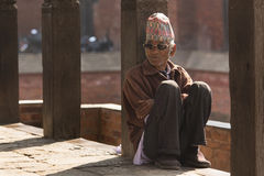BHAKTAPUR, NEPAL - NOVEMBER 20: Portrait of unkown man staying a. Nd relax in Bhaktapur on November 20, 2014 in Bhaktapur, Nepal Stock Image