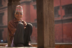 BHAKTAPUR, NEPAL - NOVEMBER 20: Portrait of unkown man staying a. Nd relax in Bhaktapur on November 20, 2014 in Bhaktapur, Nepal Royalty Free Stock Images