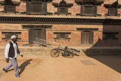 BHAKTAPUR, NEPAL - NOVEMBER 20: Portrait of unkown man walking o Stock Photo