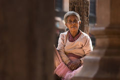 BHAKTAPUR, NEPAL - NOVEMBER 20: Portrait of unkown woman staying Stock Photos