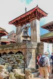 Bhaktapur, Nepal - November 04, 2016: Tourists near the Barking Bell in Durbar Square, Kathmandu, Nepal. Asia Stock Photo