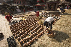 BHAKTAPUR, NEPAL - NOVEMBER 20 :Unidentified man carrying pots o Stock Photo
