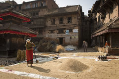 BHAKTAPUR, NEPAL - NOVEMBER 20 :Unidentified woman working with Royalty Free Stock Images