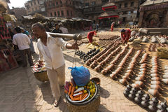 BHAKTAPUR, NEPAL - NOVEMBER 20 :Unknown man selling vegetables o Royalty Free Stock Image