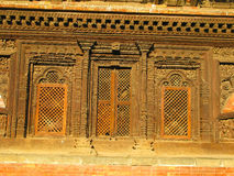 Bhaktapur Window. A fretworked wooden window in the nacient Nepalese city of Bhaktapur Stock Photos