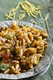 Bhel puri - A street food popular in North India. Bhel puri - Bhelpuri is a type of chaat or small plates of savory snacks, particularly identified with the Royalty Free Stock Photo