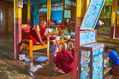 The Bhikkhu Monk in Monastery of Ywama, Myanmar. YWAMA, MYANMAR - FEBRUARY 18, 2018: The Bhikkhu monk sitting on chair in Nga Phe Chaung Monastery of jumping Royalty Free Stock Images