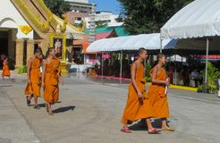 Young Buddhist monks samanera in Thailand temple wat walking on the street. A bhikkhu, an ordained male monastic. Buddhist monk Pali, Sanskrit bhiksu. Young royalty free stock images