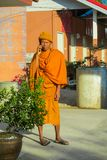 Buddhist monk bhikkhu in Thailand temple wat talking the mobile phone royalty free stock image
