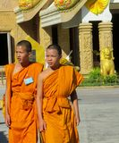 Buddhist young monks walk in the temple yard. A bhikkhu, an ordained male monastic. Buddhist monk Pali, Sanskrit bhiksu. Young Buddhist monks samanera srama stock photos