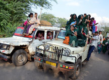 Bhil tribe girl in India. Bhil tribe girls in India going to participate in local tribal fair by overloaded vehicle Royalty Free Stock Photo