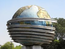 Bhilai, Chhattisgarh, India - October 26, 2009 Huge blue color globe statue. Huge blue color globe statue at Sector 10 circle with green trees and blue sky on stock image