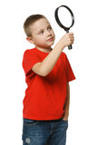 Bhild looking through the magnifying glass Royalty Free Stock Photos