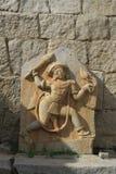 Bhima雕塑与在手中gada的,亨比 免版税库存图片