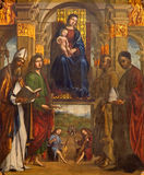 BHologna - Madonna and the saints by Laurentius Costa (1497) from side altar in church San Giovanni in Monte. Royalty Free Stock Images