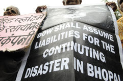 Bhopal. BHOPAL-DECEMBER 2:Victims with a banner ask Dow chemical to accept liabilities for the tragedy during a rally to mark the 26th year of the Bhopal Gas Stock Photo