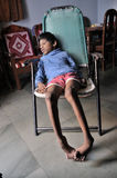 Bhopal. NOVEMBER 30:9 years old Sitesh who is suffering from Spastic Cerebral Palsy and Spina bifida which restricts his movement and speech sitting in his royalty free stock photos