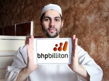 BHP Billiton company logo. Logo of BHP Billiton company on samsung tablet holded by arab muslim man. BHP Billiton is an Anglo-Australian multinational mining Stock Image