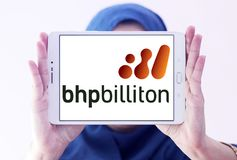 BHP Billiton company logo. Logo of BHP Billiton company on samsung tablet holded by arab muslim woman. BHP Billiton is an Anglo-Australian multinational mining Stock Image
