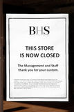 BHS department store closed sign. Carmarthen, UK, October 22, 2016 :  Store closed sign in the window of empty BHS department store in the city centre Royalty Free Stock Image