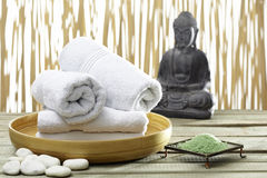 Bhuddha, towels, bath salts Royalty Free Stock Photos