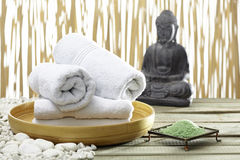 Bhuddha, towels, bath salts Stock Images