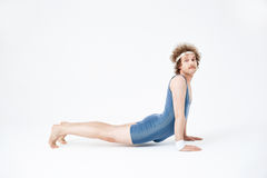 Man In Blue Jumpsuit Practising Yoga For First Time Doing His Best