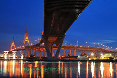 Bhumibol Bridge across river with light trail at twilight Royalty Free Stock Image