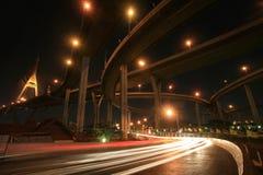 Bhumibol bridge architecture with vehicle lights. Transportation background: Bhumibol bridge architecture with vehicle lights on the street by long exposure Royalty Free Stock Photo
