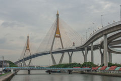 Bhumibol Bridge or Bridge of Industrial Rings is concrete highway overpass and cross the Chao Phraya River, Thailand. Foreign text on the bridge is the name ` stock photo