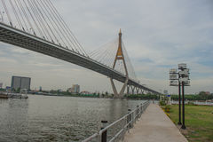 Bhumibol Bridge or Bridge of Industrial Rings is concrete highway overpass and cross the Chao Phraya River, Thailand. Foreign text on the bridge is the name ` royalty free stock images