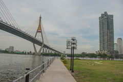 Bhumibol Bridge or Bridge of Industrial Rings is concrete highway overpass and cross the Chao Phraya River, Thailand. Foreign text on the bridge is the name ` stock images
