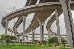 Bhumibol Bridge or Bridge of Industrial Rings is concrete highway overpass and cross the Chao Phraya River, Thailand. Foreign text on the bridge is the name ` Stock Photography