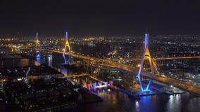 Bhumibol Bridge, Chao Phraya River, and buildings at night in transportation concept, Bangkok city, Thailand.  stock video