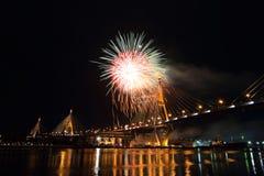 Bhumibol Bridge and Fireworks on around Royalty Free Stock Photo