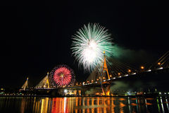 Bhumibol Bridge and Fireworks on around Stock Photography