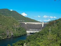 Bhumibol dam was built to collect and reserve water on Ping river, Thailand. Bhumibol dam in the sun, a concrete arch dam on the Ping River, was built for the royalty free stock image