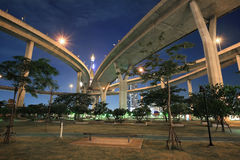 Bhumibol Industrial circle bridge above park Stock Photo