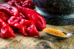 Bhut Jolokia on wooden table Stock Photos