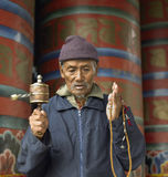 Bhutan. A Buddhist pilgrim praying with a prayer wheel in the Kingdom of Bhutan Stock Photography