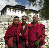 Bhutan - Buddhist Monks. Young Buddhist monks near Paro Dzong in the Kingdom of Bhutan Royalty Free Stock Photo