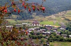 Bhutan, Bumthang, Ura,. Bhutan, mountain village Ura with homes and traditional Dzong royalty free stock photography