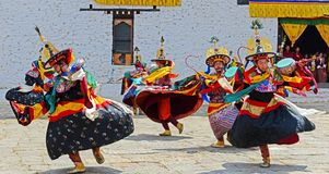 Bhutan Festival. Dancers at the Paro Tsechu (religious festival) in The Kingdom of Bhutan in the Land of the Thunder Dragon high in the Himalayas Stock Image