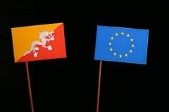 Bhutan flag with European Union EU flag isolated on black. Background Stock Photos